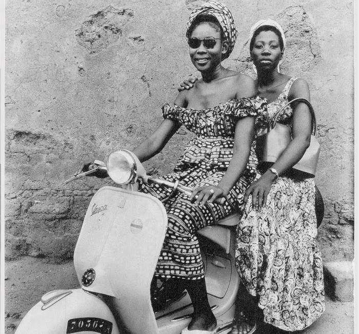 Two young African women on a Vespa