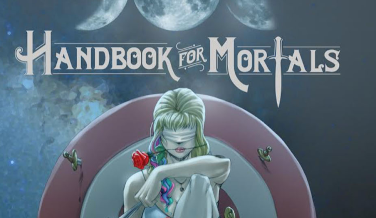 "Cover of ""Handbook for Mortals,"" showing a blindfolded woman with a rose in her mouth"