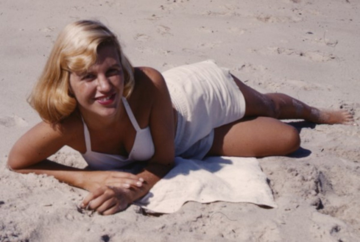 Sylvia Plath on the beach in a modest white two-piece swimsuit