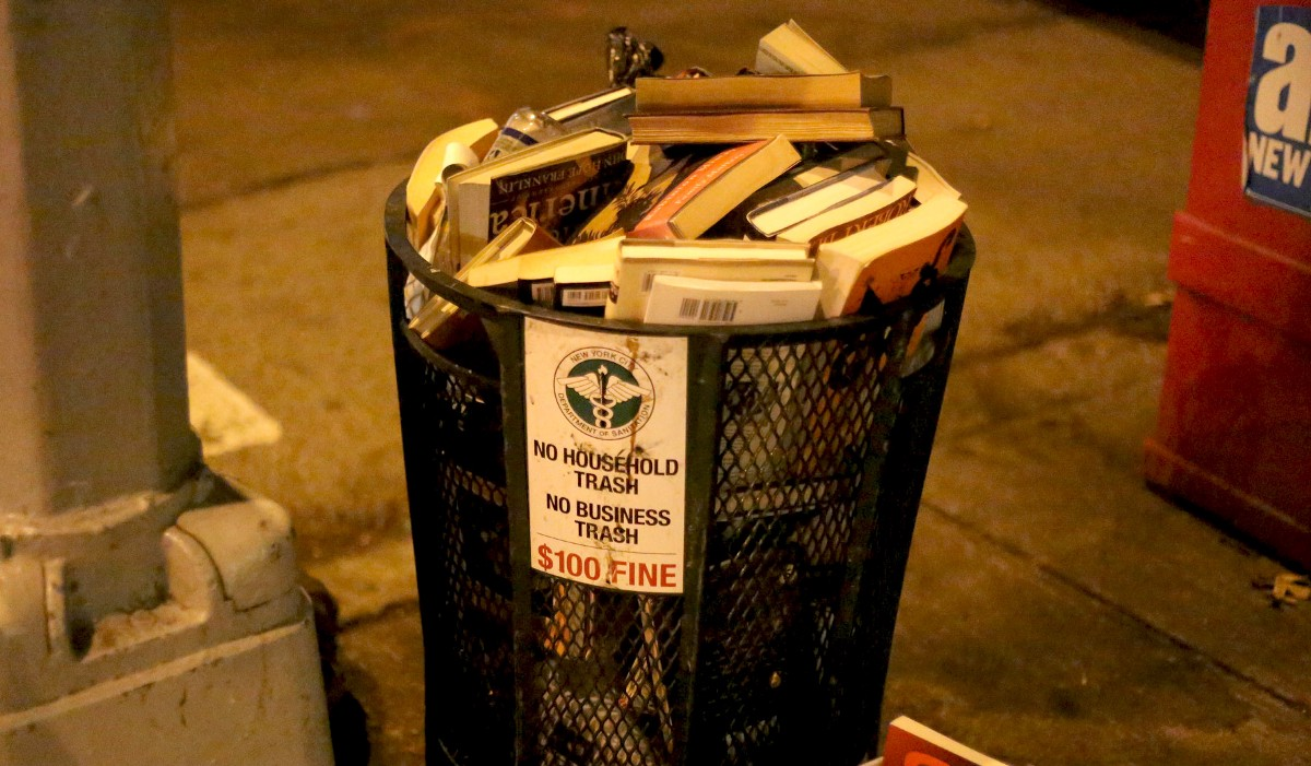 Trash can full of books