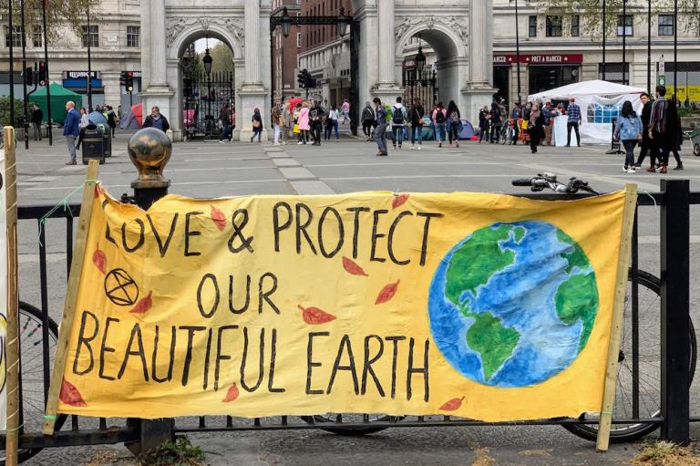 "Banner reading ""Save & Protect Our Beautiful Earth"""
