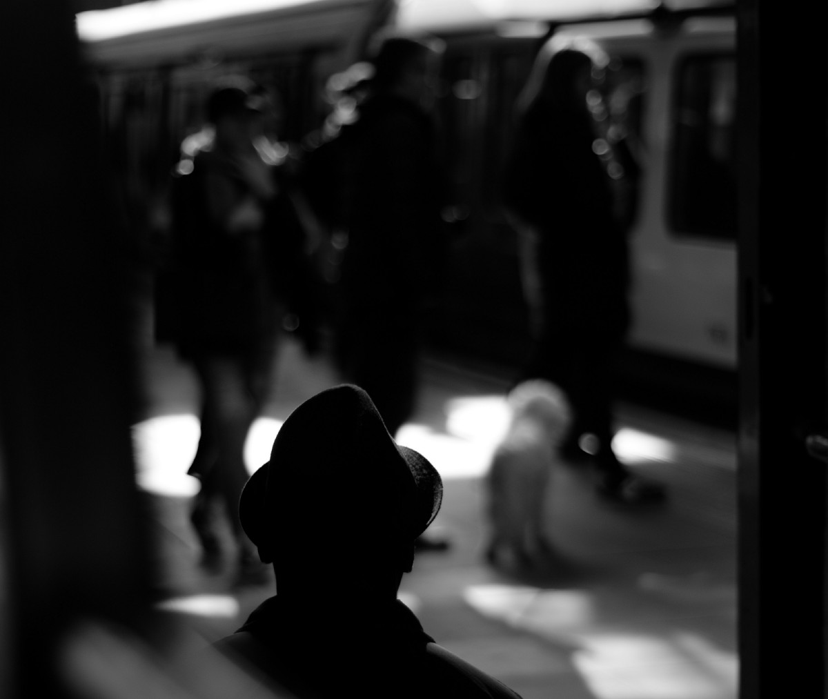 Shadowy man in train station