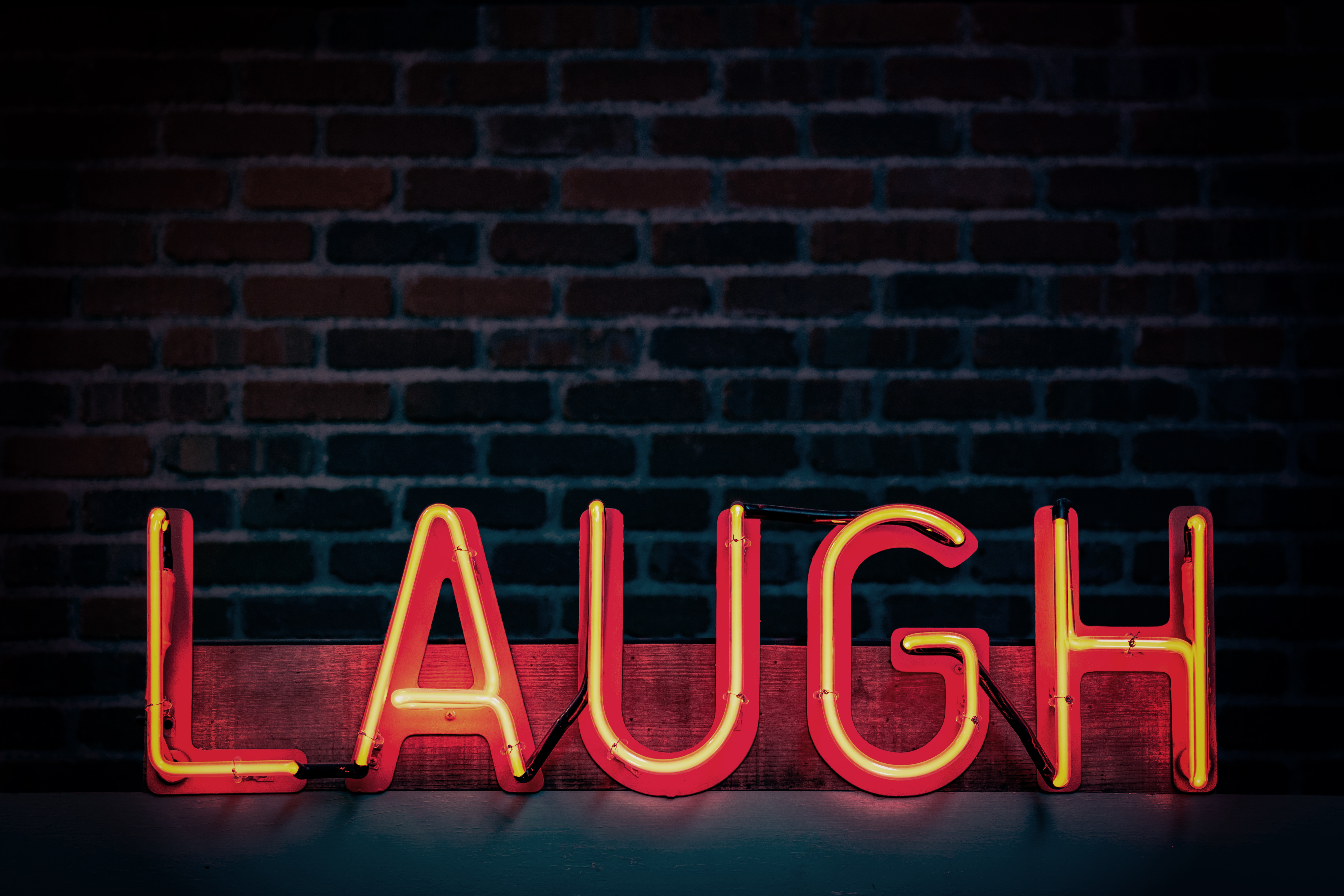 Laugh, neon sign