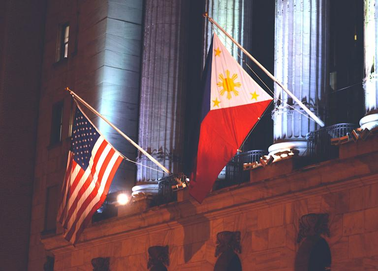 Phillipines and American flags at the New York Stock Exchange
