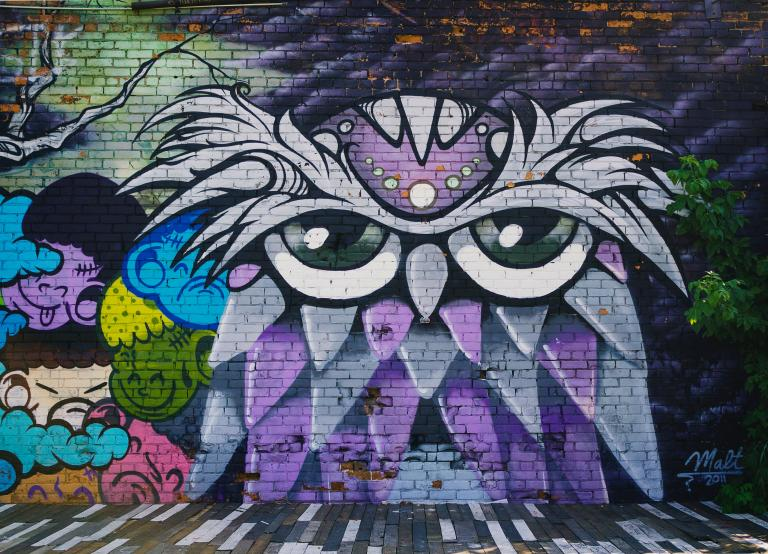 Cartoonish mural of a sleepy-looking owl