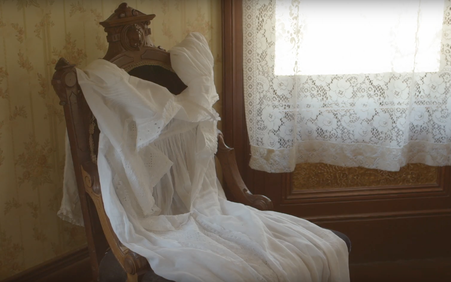 An abandoned white dress, screenshot from Wild Nights with Emily