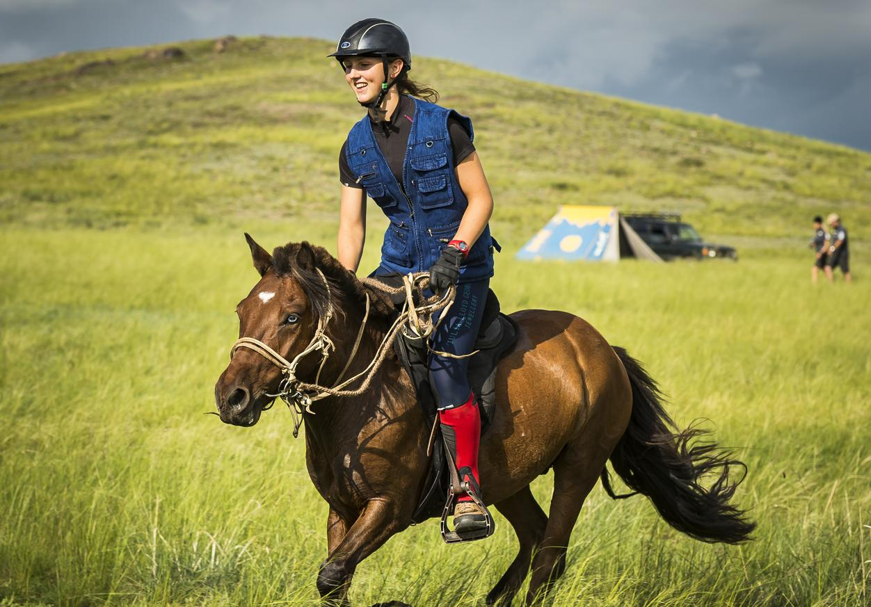 Lara Prior-Palmer riding a horse at the 2013 Mongol Derby