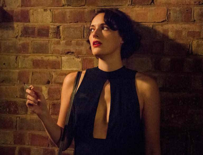 Screenshot from Fleabag, jumpsuit and smoking cigarette