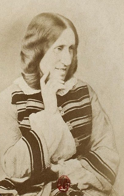 Sepia photograph of the author George Eliot in 3/4 profile, showing that she has a large nose