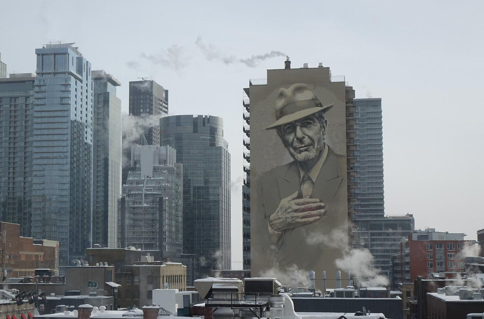Montreal cityscape with huge Leonard Cohen mural