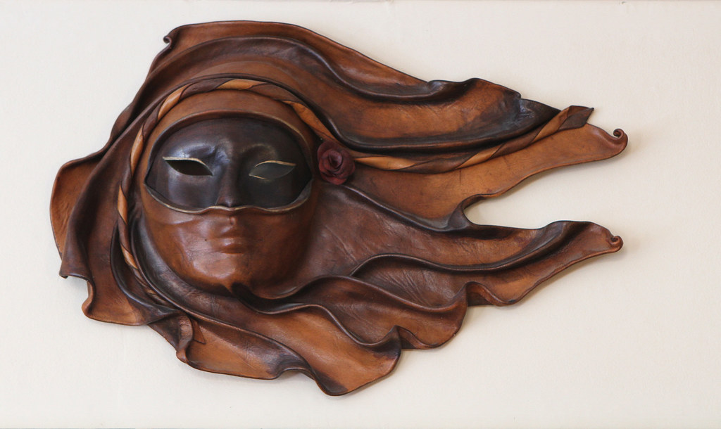 Leather mask that is also wearing a smaller mask