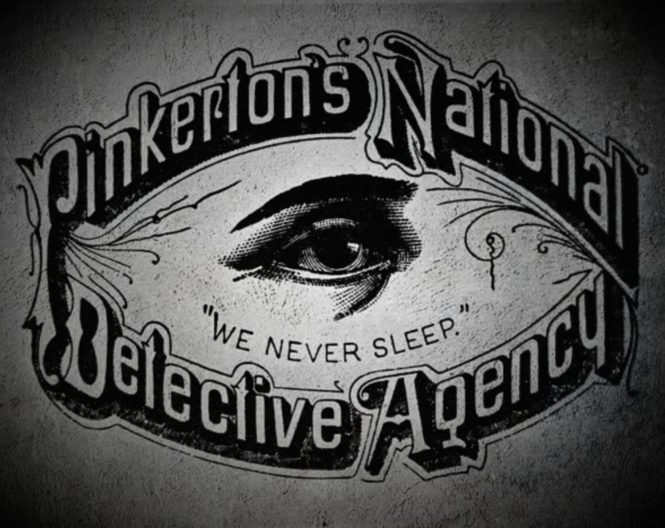 "Old Pinkerton logo, featuring an eye with the caption ""We Never Sleep"" surrounded by the words ""Pinkerton's National Detective Agency"""