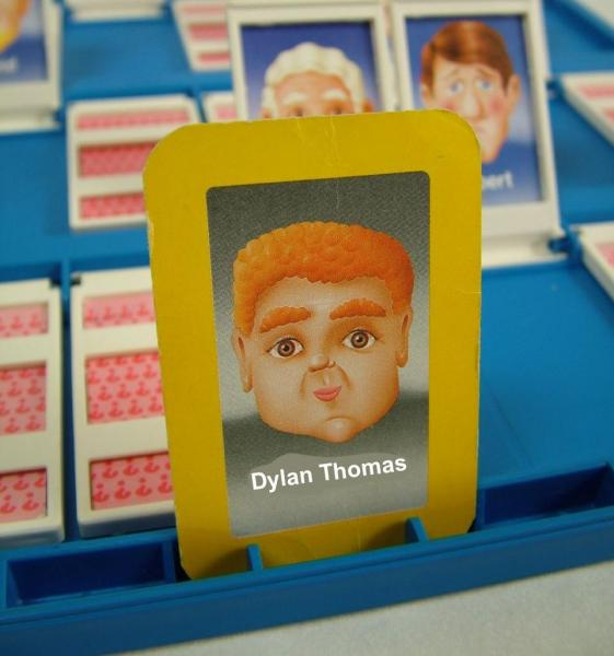 Guess Who? board altered so that the character with red curly hair and a square face is identified as Dylan Thomas