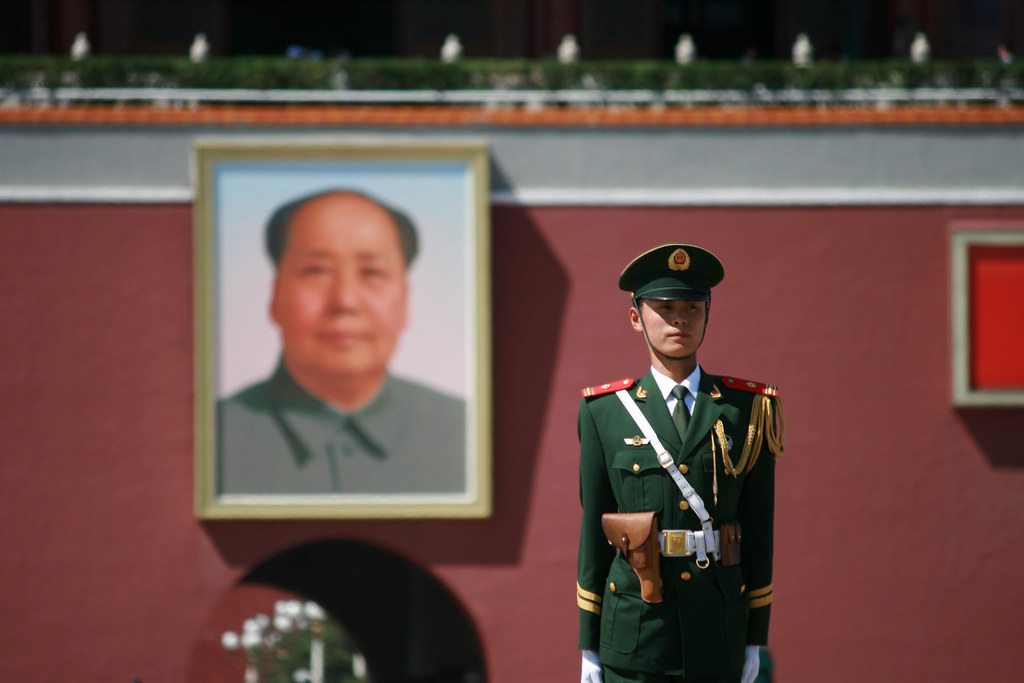 Guard in front a portrait of Chairman Mao in Tiananmen Square