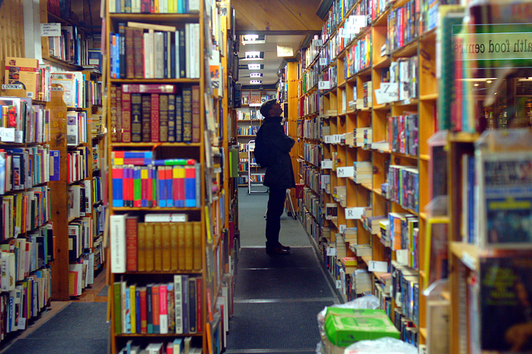 Man looking at the shelves in a bookstore