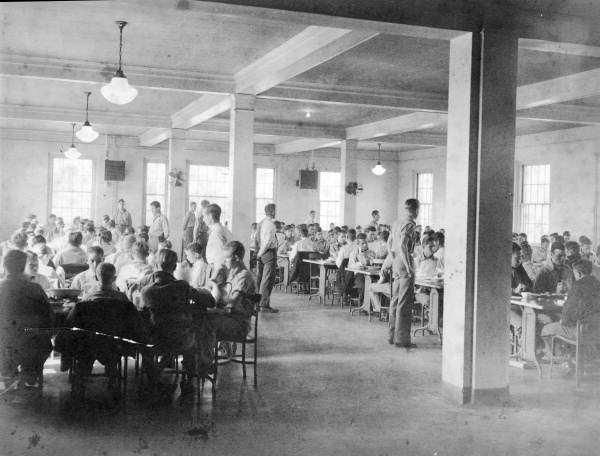 1950s photograph of a crowded institutional cafeteria full of boys