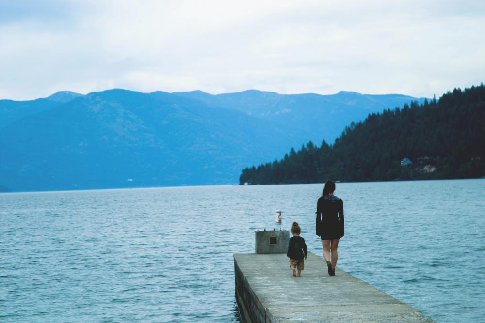 Woman and child on a dock by a lake