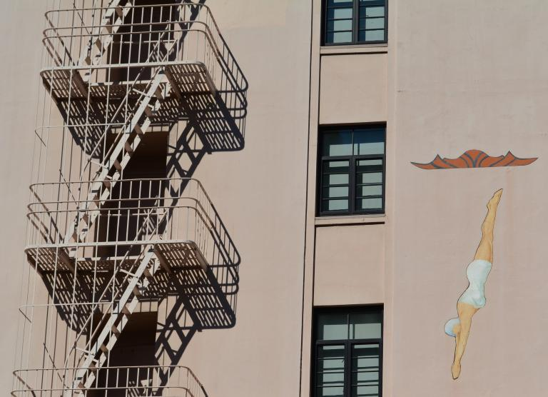 Fire escape with swimmer diving mural
