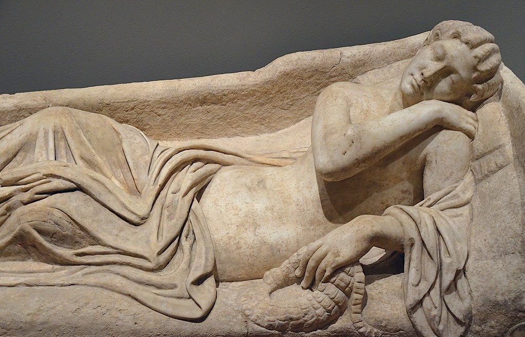 An 1,800-year-old sarcophagus lid depicting sleeping Ariadne by Carole Raddato via Flickr