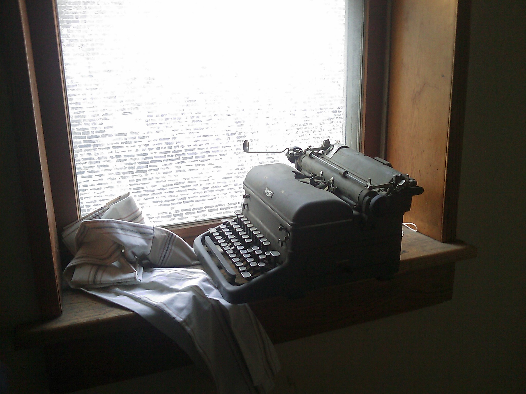 Old Royal typewriter sitting on a windowsill