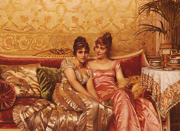 Two women gossiping on a couch