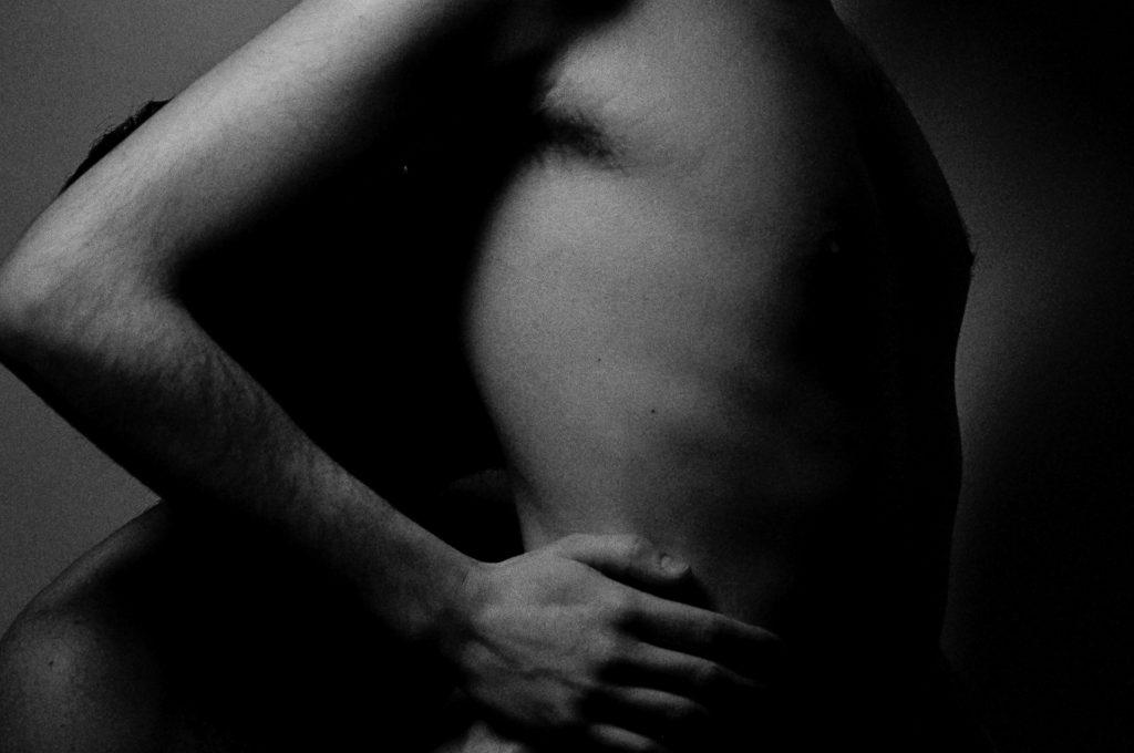 Black and white photo of man's torso
