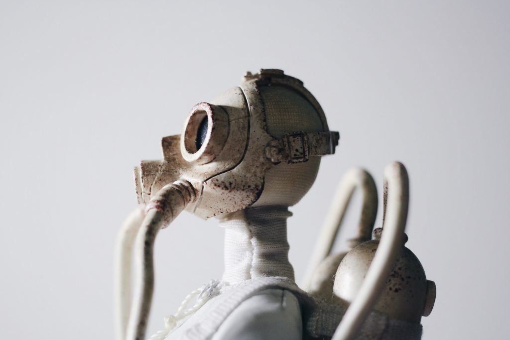 Spooky sculpture of a person in a gas mask