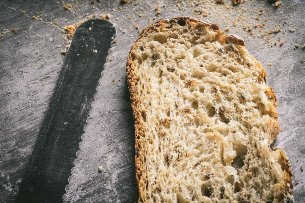 Slice of sourdough bread and serrated knife