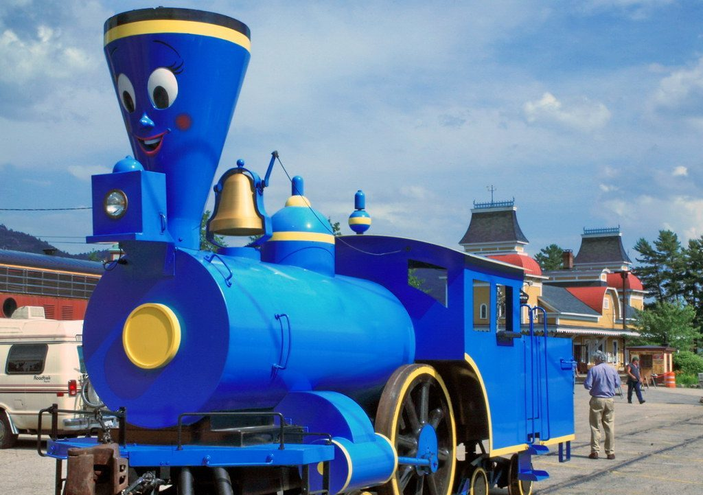 A real locomotive painted blue with a face like the Little Engine That Could from the book