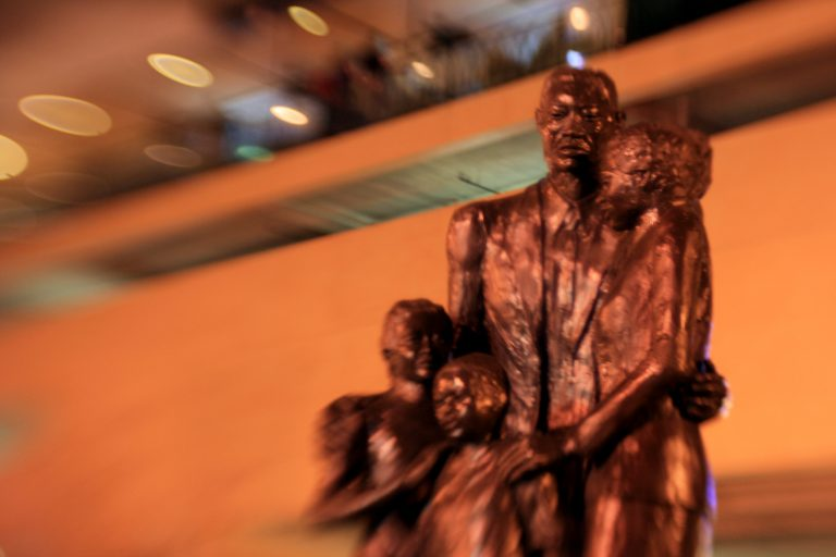 Statue of Black family standing together