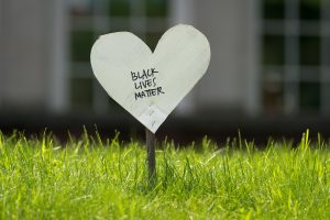 """""""Black Lives Matter"""" written on white paper heart"""