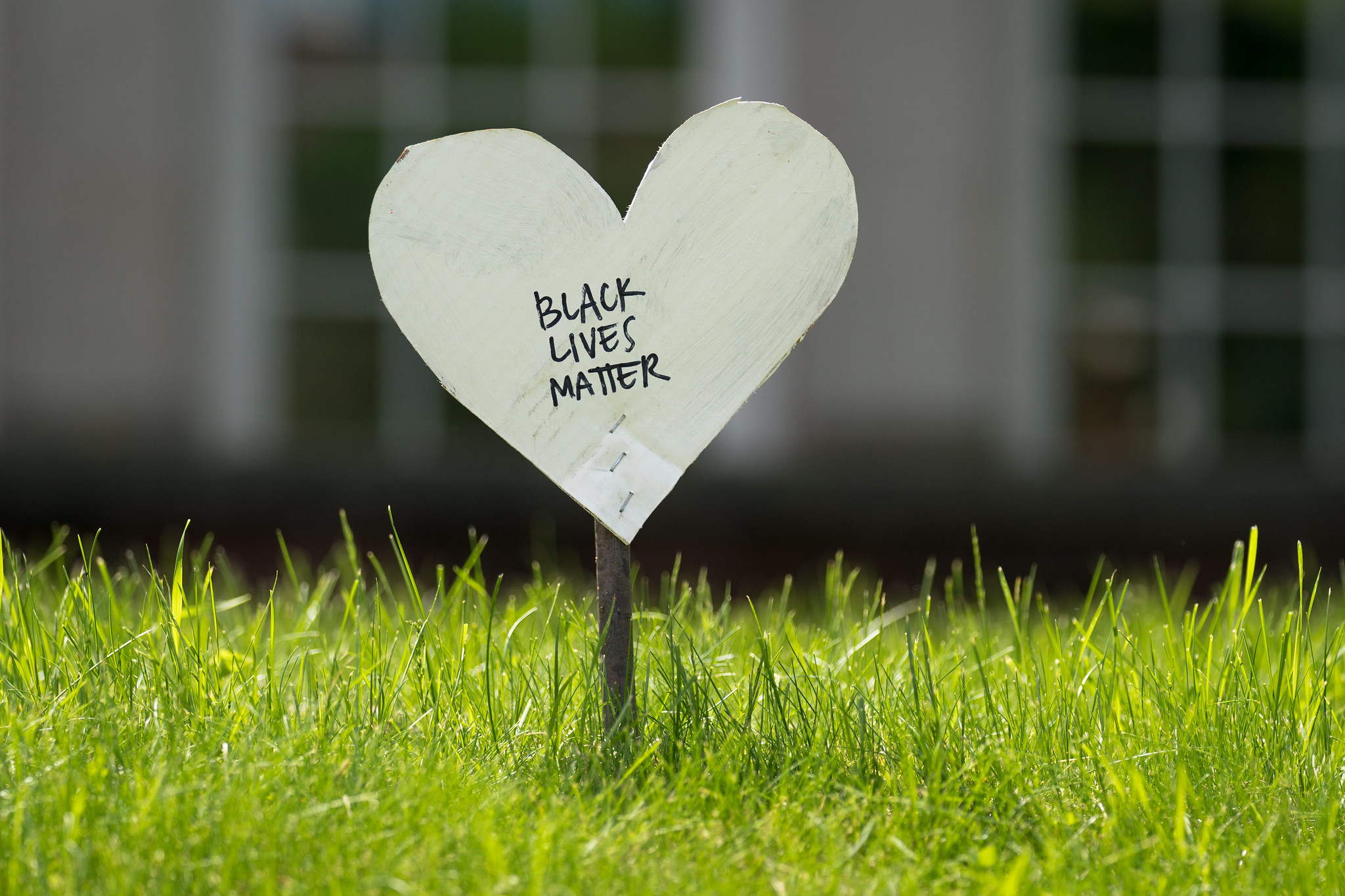 """Black Lives Matter"" written on white paper heart"