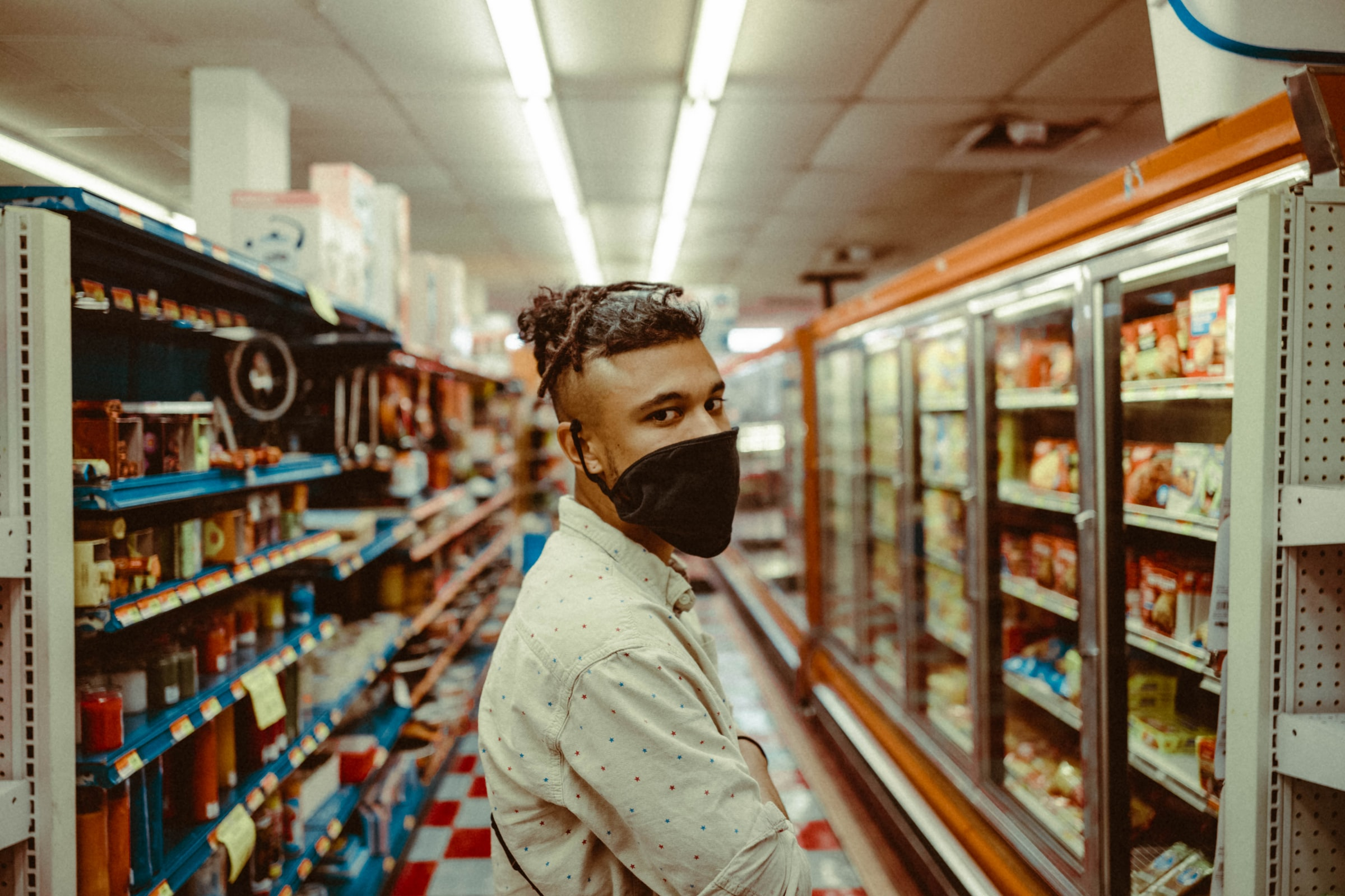 Person with mask in grocery aisle