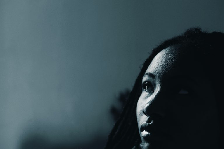 Black girl in monochrome looking serious