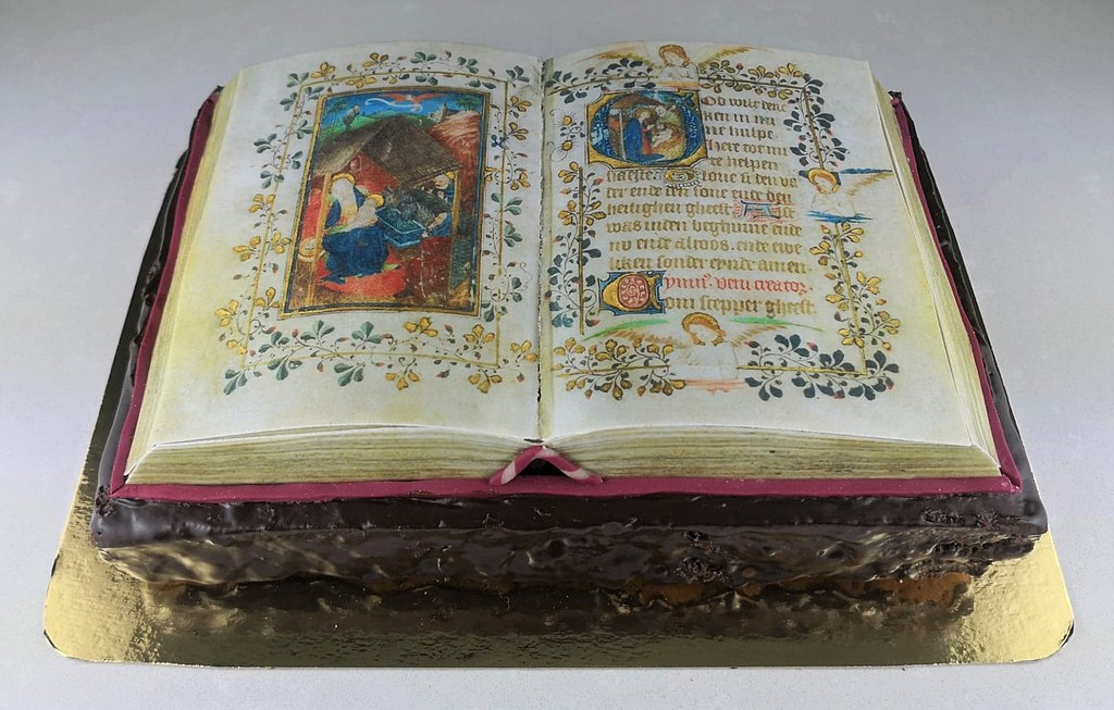 Cake in the shape of an illuminated manuscript book