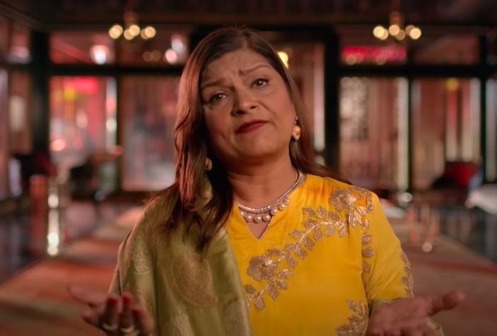 Matchmaker Sima Taparia in yellow sari