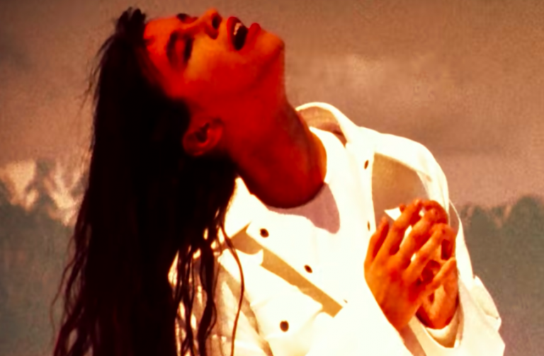 """Alanis looking prayerful in the """"You Oughta Know"""" video"""