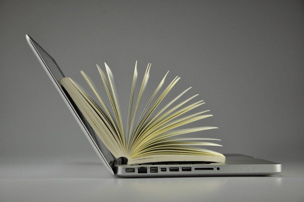 Book nestled inside laptop