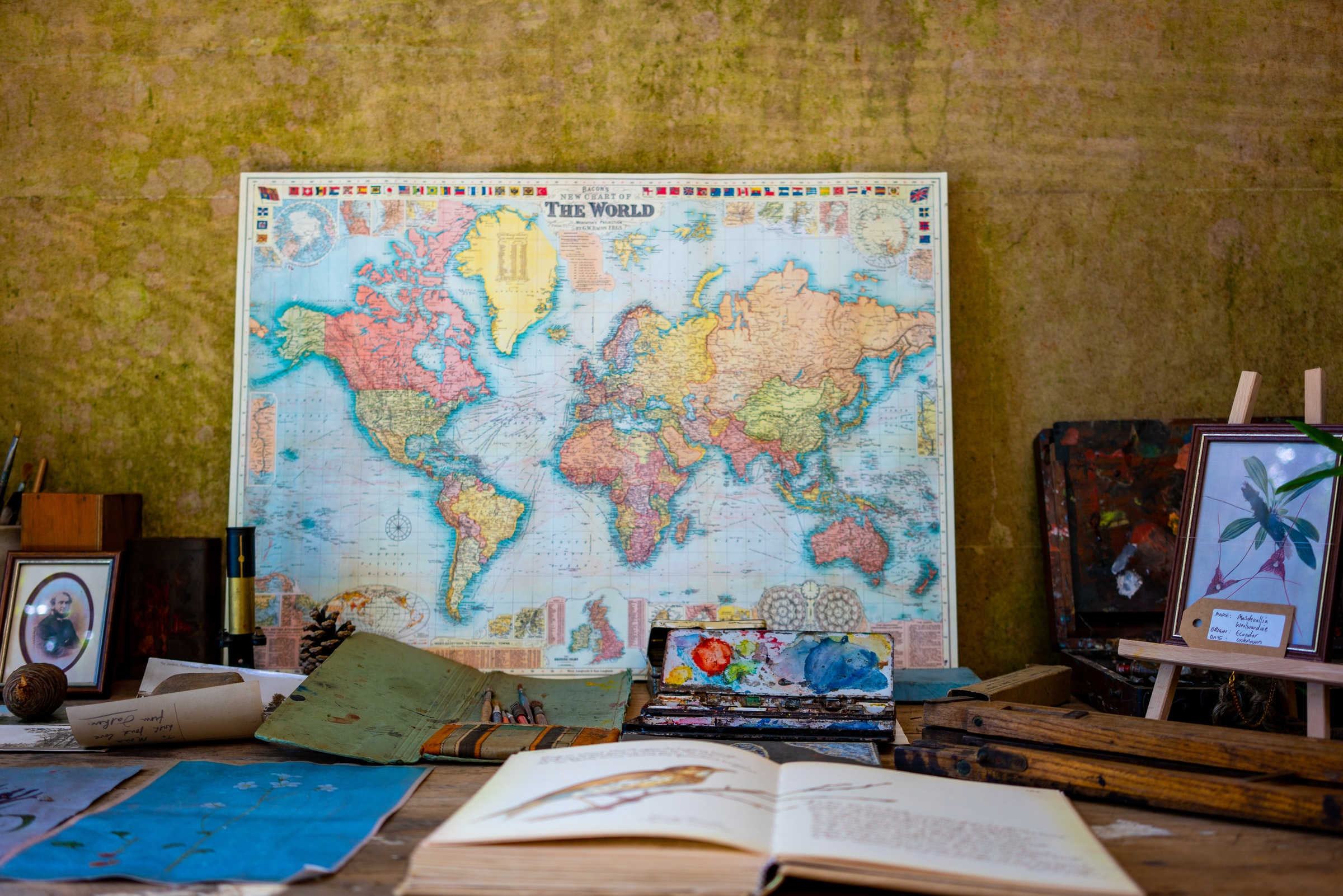 World map with book in front