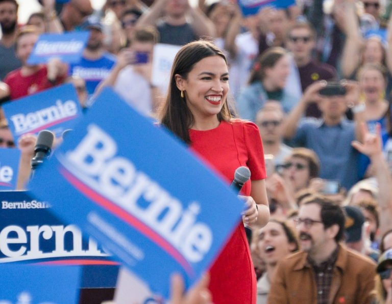 """Alexandria Ocasio-Cortez joins hands with Bernie Sanders in her first public endorsement of his campaign"" by NSPA & ACP 2020 is licensed under CC BY-NC 2.0"