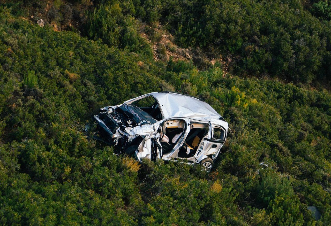 A car wreck in a field