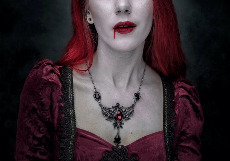 woman with blood dripping from her mouth