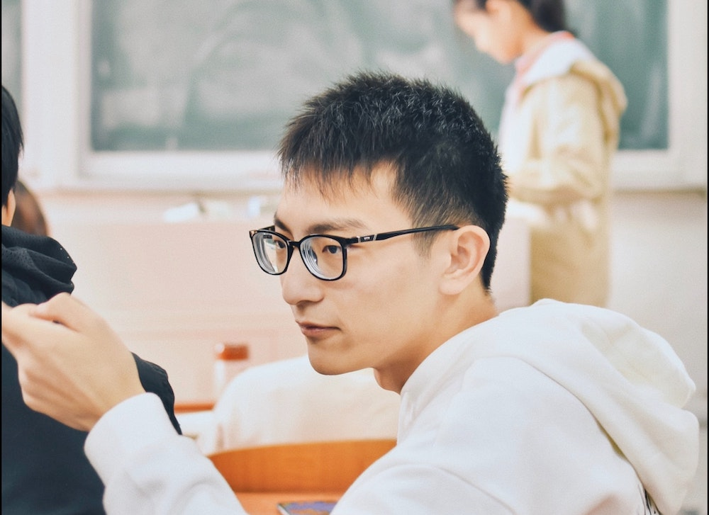 Asian boy in high school classroom
