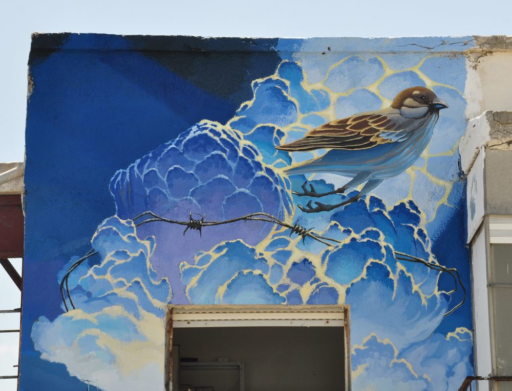 Mural of bird on side of building