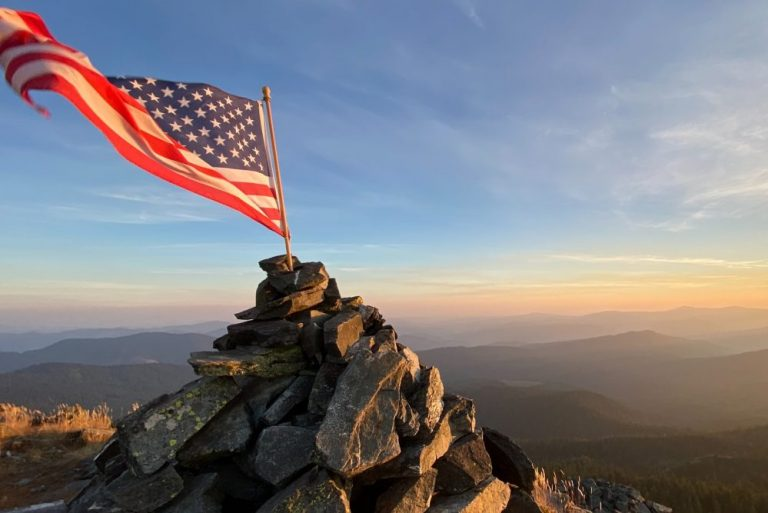 American flag on top of pile of rocks