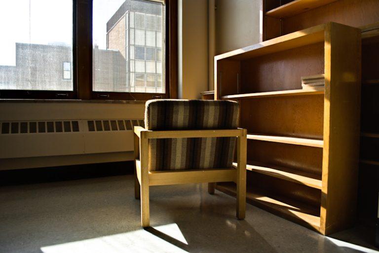 Chair and empty bookshelf