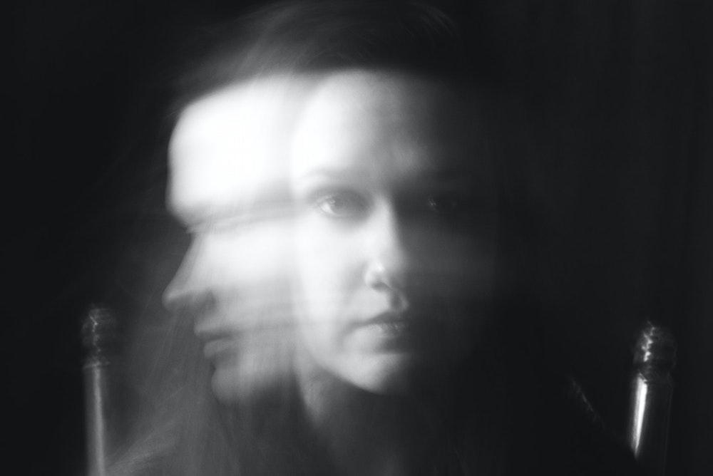 Woman's face blurred by movement
