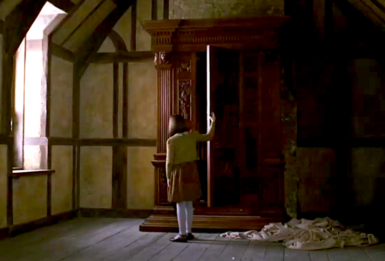 """Lucy opening the wardrobe in the 2005 film of """"The Lion, the Witch, and the Wardrobe"""""""