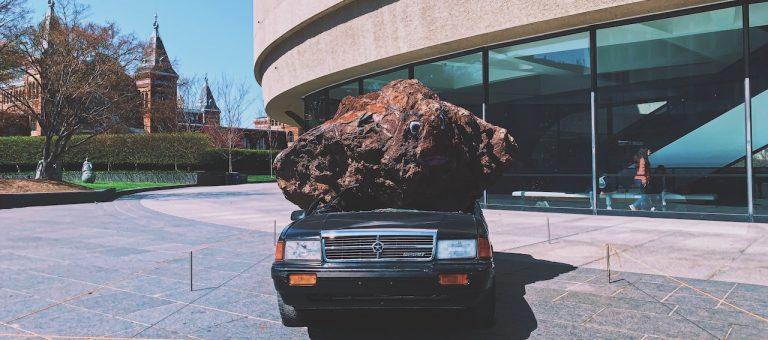 rock on car