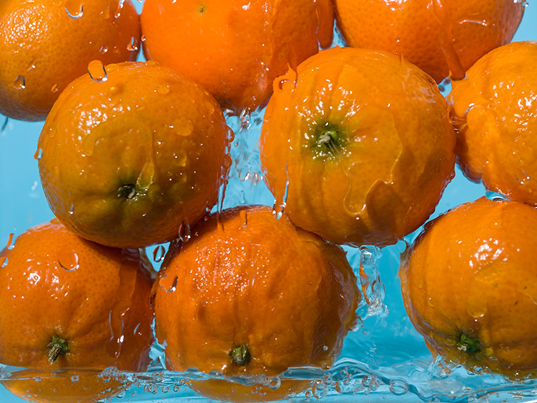 Citrus fruits drenched in water
